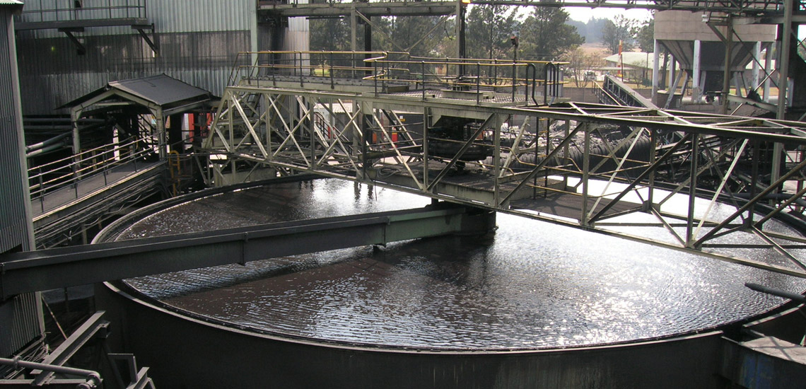Coal tailings conventional thickener showing feed launder and bridge in South Africa
